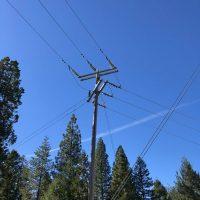 PGE-Kortik Dbl deadend turn angle gray on wood pole far